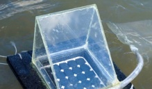 An angular device floating on lake water.