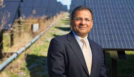 Amit Goyal in front of UB's Solar Strand.