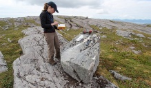 Alia Lesnek surveys rocks in Alaska