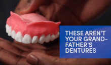 Man holding a pair of dentures