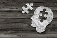 An illustration showing a puzzle piece and a head with a section the shape of the puzzle piece missing.