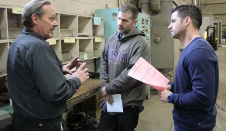 B&W Heat Treating Shop Foreman Fred Myers, far left, explains a matter to the company's president, Kevin Calvello. At center is Matt Ryan.