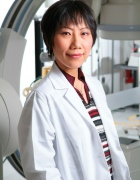 portrait of Hui Meng in the lab.
