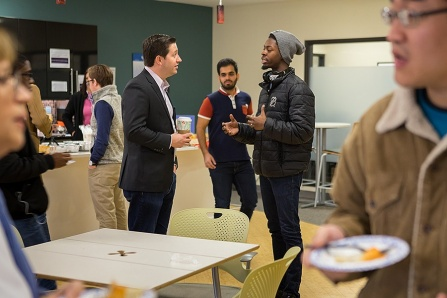 Bradley Cheetham spoke with students during his visit to the Honors College International Café event.