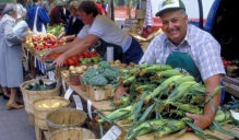 A farmer shows off his corn crop at the UB farmers market.