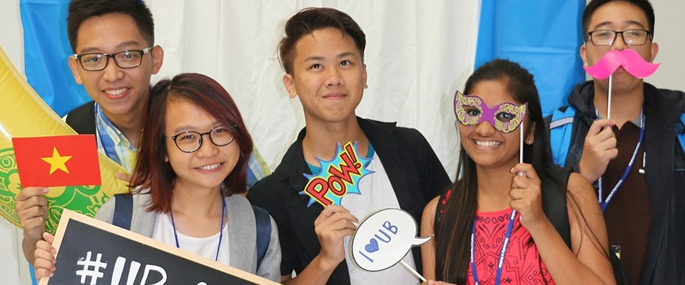 Students posing in a photobooth